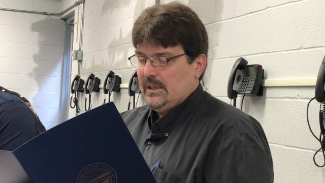 John Turley of Coshocton Behavioral Health Choices reads a proclamation from the governor's office recognizing the importance of local efforts in fighting the state opioid crisis.