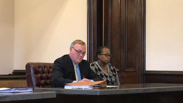 Attorney Jerry Thompson and his client Chrisala K. Bradley listen to Judge Robert Batchelor review her case Wednesday in Coshocton County Common Pleas Court.