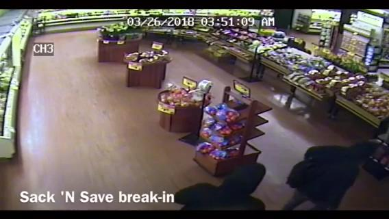 Surveillance video captures a glimpse of two people of gained access to the Sack 'N Save by cutting a hole through the store's roof. The pair also cut a hole in the store's safe and got away with the store's cash on hand.