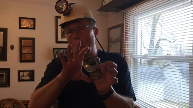 Sam Bennett of Coshocton shows some of the items and how they work from his collection of coal mine memorabilia collected locally and beyond.