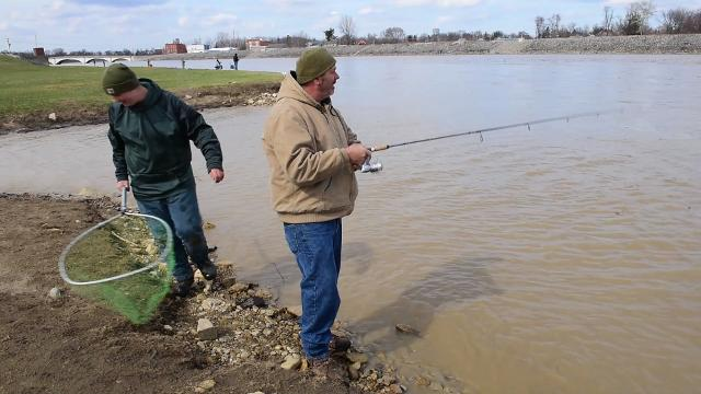 Anglers brave the cold April weather to fish the Sandusky River.