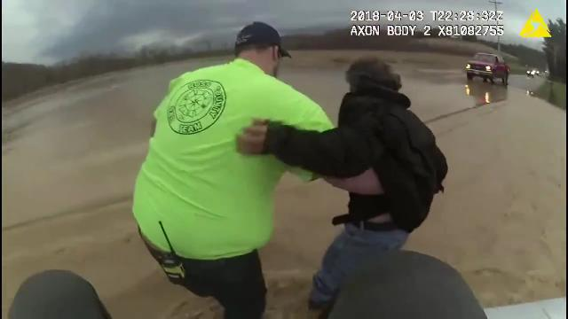 Ross County Sheriff's Deputy Mitch Reffett's body camera captures how he and Harrison Township Firefighter Nate Kahrig rescued a couple from an SUV swept off Possum Hollow Road by flood waters on April 3, 2018.