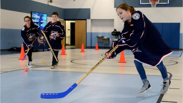Medill Elementary fourth graders won photo contest that brought a Columbus Blue Jackets pep rally to the school Friday, April 13, 2018.