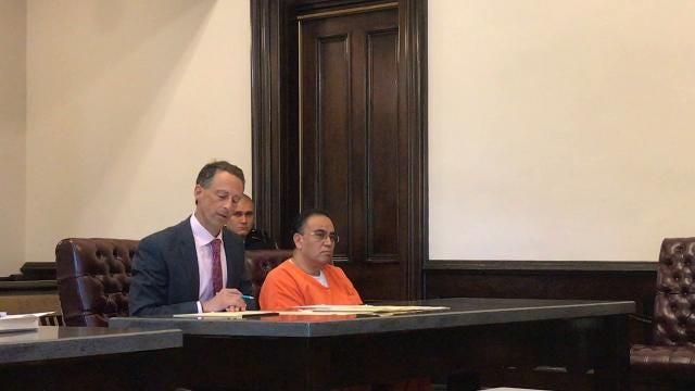 Attorney Lawrence Levinson and his client, David A. Velasquez, address Coshocton County Common Pleas Court on Thursday. Velasquez admitted to violating terms of his probation by entering the U.S. without alerting his probation officer.