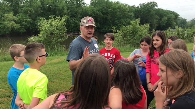Robin Reash explains what fossils are to students at the recent Earth Day event at the AEP Plant in Conesville.