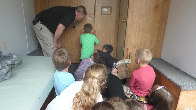 """The Troy Township and Mansfield Fire DepartmentS helped students from Central Elementary in Lexington through a """"fireman's challenge course"""" and Troy Township also arranged for the House of Hazards trailer."""