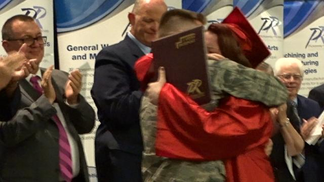 Airman First Class Andrew Carothers surprises his sister, Jossalynn, on stage during Thursday's Pickaway-Ross CTC completion ceremonies.