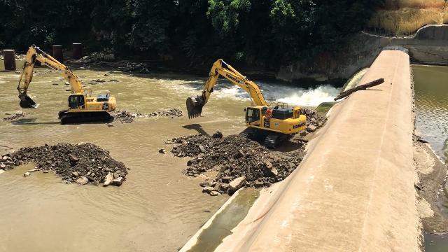 Demolition of the 105-year-old Ballville Dam started Monday.