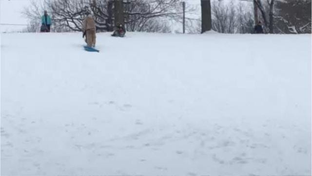 Families enjoyed some good, old-fashioned fun sledding at Liberty Park hill Saturday in Mansfield.