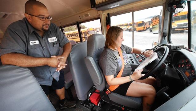 What kind of training do new school bus drivers get?