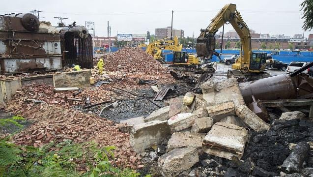 Pensupreme smokestack reduced to rubble