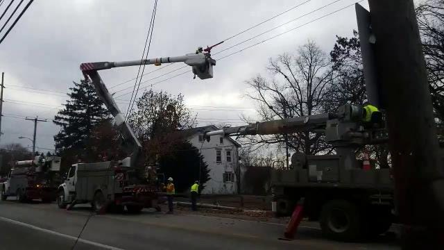 Crew work to repair an electrical pole after a car crash on Broadway on Thursday.