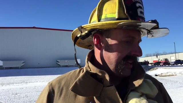 Waynesboro fireman Trayer Stoops, who is also a Hagerstown Fire Dept.captain, talks about the fire near a 30,000 gallon propane tank at Fil-Tec, Inc., in the Wharf Road Road Industrial Park, Washington Township.