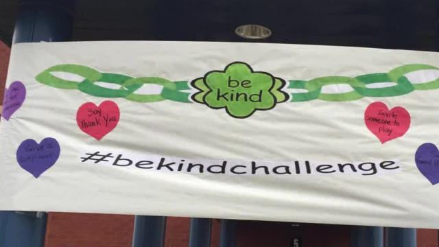 """Community members, including state police and Marion firemen, greet students at Marion Elementary School, Monday, February 12, 2018. As part of an initiative to promote kindness, CASD elementary school counselors are leading a """"week of kindness"""" at each elementary school.  #bekindchallenge"""