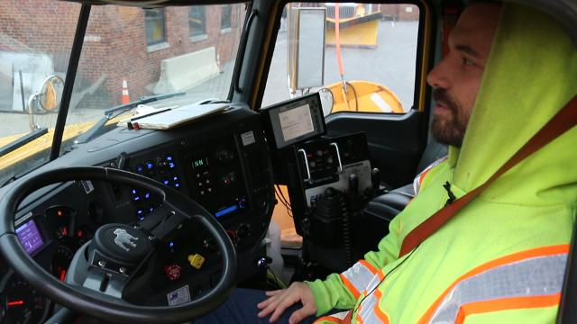 Working the controls of a PennDOT snowplow