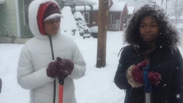 Sisters Ashanta Banks, 15, and Aunjalea Banks, 13, and their cousin, Najaee Williams-Banks, 13, were shoveling snow in York Wednesday.