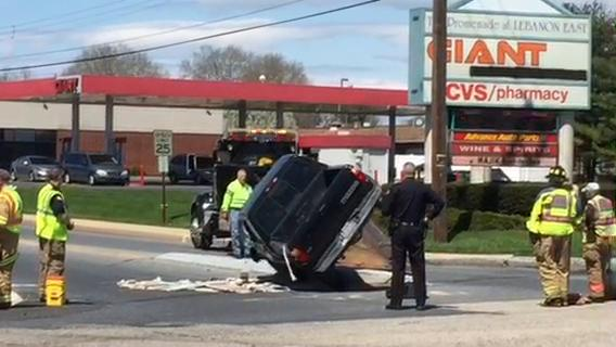 Crews load overturned pickup on to flatbed after two-vehicle collision at E. Cumberland and Walnut in Lebanon on April 30, 2018.