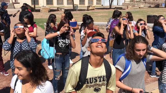 Students and faculty from Austin High School ate donuts and watched the solar eclipse of 2017 in the schools quadrangle Monday morning.