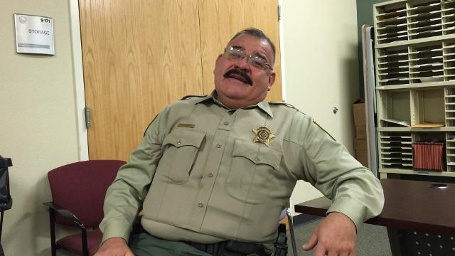 Daniel Ramondo, a Doña Ana County Sheriffs Deputy, who draws caricatures of fellow Deputies as well as past and present Sheriffs, in his office at the DASO offices where the walls are covered in his art work.