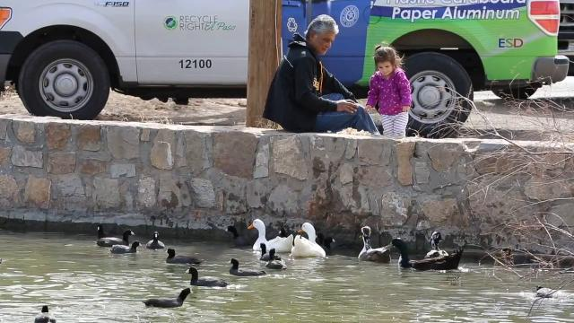 Warm temperatures brought out Pablo Vargas and his granddaughter Taylor Caterina 2 to Ascarate Park Lake Monday morning as they fed the ducks together under a warm El Paso sky.