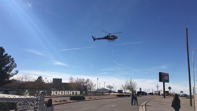 Beer bottles,broken glass and fake blood covered the streets of an intersection near Oñate High School on Thursday as students watched the aftermath of a simulated DWI crash meant to illustratethe consequences of drinking and driving.