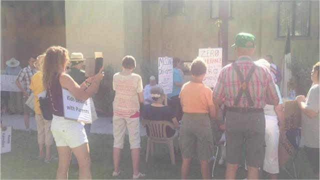 More than 100 people gathered in Carlsbad to protest the separation of families crossing the U.S./Mexico border.