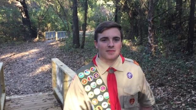 Boy Scout Russell Salyer of Norfork talks about the process of replacing two of the bridges on the Clysta Willett Park nature trail for his Eagle Scout project.