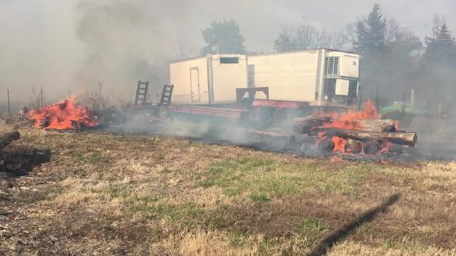 A fast moving brush fire threatened homes Monday on Old Military Road