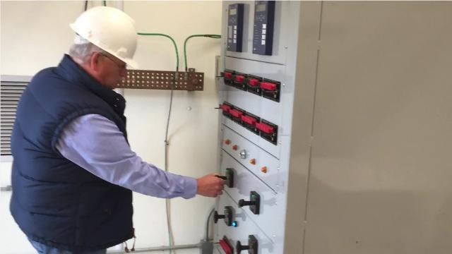 North Arkansas Electric Cooperative CEO Mel Coleman energizes the co-op's Clarkridge Substation on Feb. 14, 2018, and ushers in the familiar electric buzzing sound often heard around power lines and substations.
