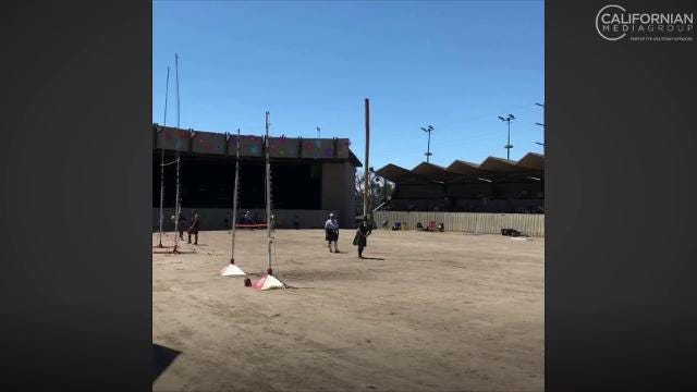 Eric Berjaran, the final contestant in the video, tosses and flips a caber