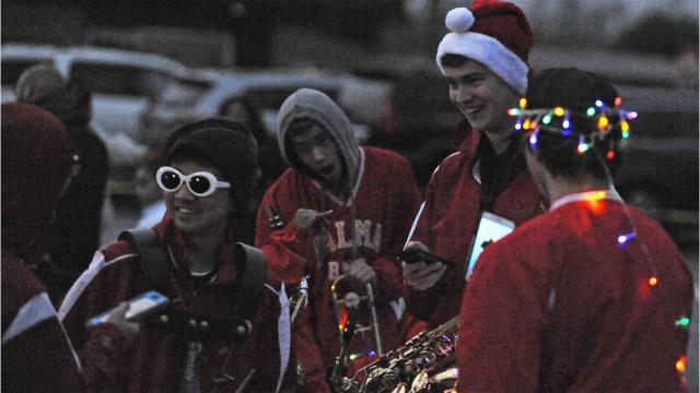 Salinas Parade of Lights celebrates its 17th anniversary as crowds dodge raindrops.