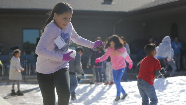 In an event that also promotes literacy, the Cesar Chavez Public Library held its fourth annual Snow Day on Wednesday with loads of the frosty goodness imported just for fun.