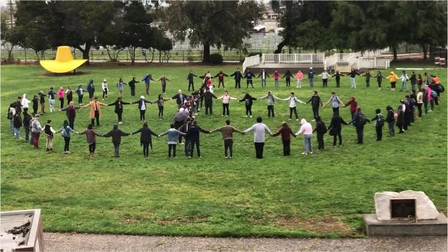 Students at Millennium Charter School form a peace sign as part of National Walkout Day to call attention to school shootings and how to prevent them.