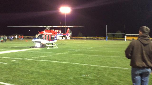 Helicoptor lands on field before Briggsdale homecoming game