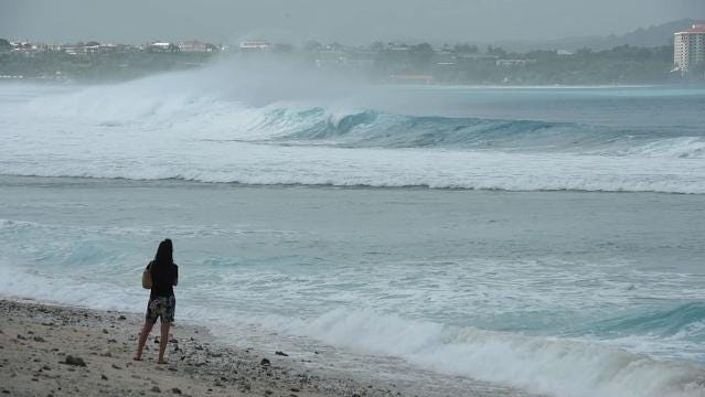 Normally calm waters inside Tumon Bay have been replaced by huge waves crashing on the reef.