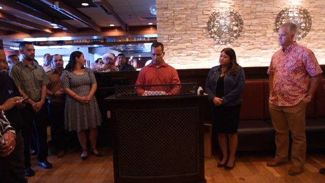 Outback Steakhouse and Triple J Enterprises, Inc. are presented with Resolution 302-34 (LS) from Sen. Frank Aguon, Jr., for their years of service to the island, during a presentation at Outback Steakhouse in Tumon on Dec. 15, 2017.