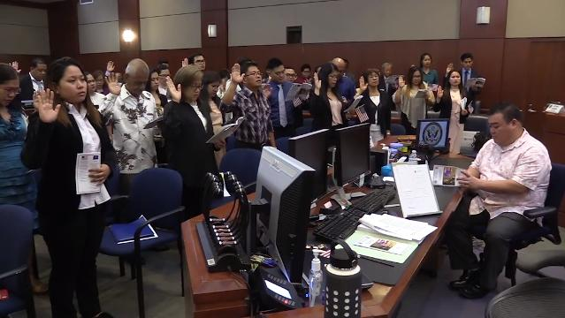The District Court of Guam welcomes 46 new United States citizens after they take the oath of allegiance during a special Martin Luther King Jr. Day naturalization ceremony on Jan. 12, 2018.