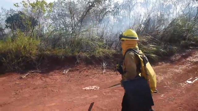 Aides from the Guam Department of Agriculture's Guam Forestry Division respond to a grass fire near LeoPalace Resort on Jan. 16, 2018.