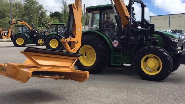 The Guam Power Authority purchase boom mowers, wood chippers and a dump truck to mitigate vegetation-growth that threatens overhead power lines in the island villages.