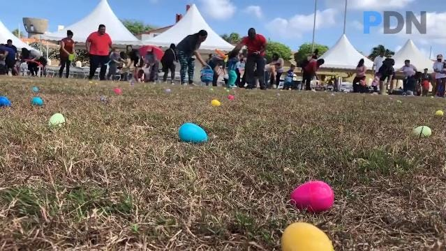 Children, family and friends scramble for Easter eggs during the first lady's egg hunt at Adelup on Thursday, March 22, 2018.