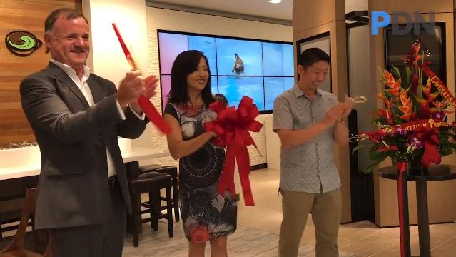 Archway, Inc. Vice President Mika Gibson announces the opening of the company's eighth and latest Infusion Coffee & Tea outlet, located within the T Galleria by DFS in Tumon.