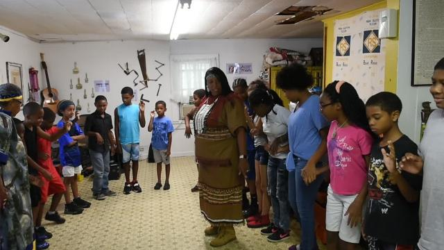 Members of the Attakapas Tribe perform a ceremonial dance to conclude the Creole Culture Summer Enrichment Program in Opelousas.