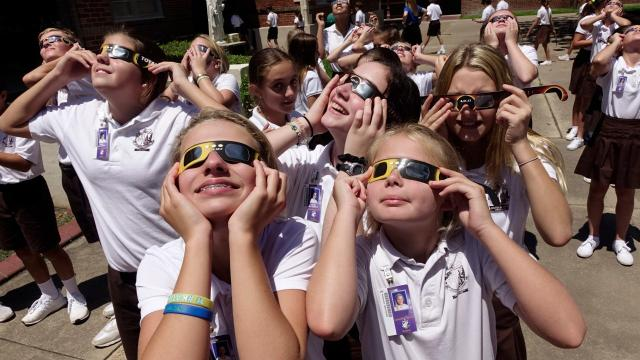 Cathedrai-Carmel students watch the solar eclipse in Lafayette Monday.