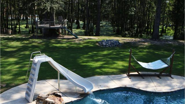 The home at 169 East Shore Road overlooks Bayou DeSiard in Monroe, La., Tuesday, Aug. 22, 2017. Complete with space for a pool table and other games, a pool with a waterslide and a room designed like a movie theatre, the 4 bedroom house is built for fun. It's currently listed at $799,900.