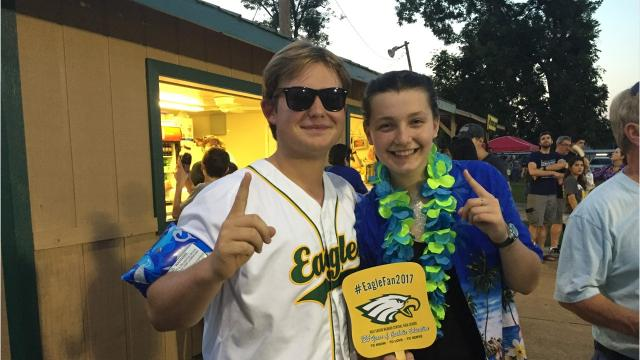 Excited football fans cheer at Menard High School football game