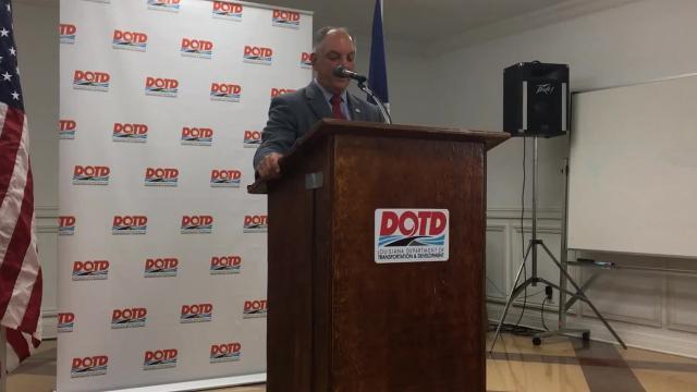 Gov. John Bel Edwards speaks at the groundbreaking ceremony for Arkansas Road improvements.