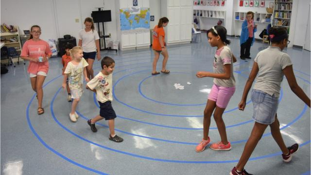 Students at Montessori Educational Center joined other children around the world by walking a labyrinth for Global Labyrinth 2017 Thursday at a labyrinth built inside the school.