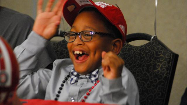 Ten-year-old Tay'Shawn Landry, who deals with cerebral palsy, joined the Ragin' Cajuns on Friday night.