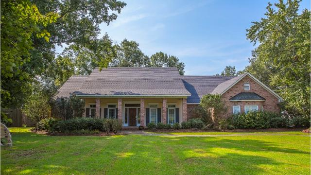The home at 4608 Bon Aire Drive features a saltwater pool, high ceilings, a guesthouse and overlooks Bayou DeSiard.