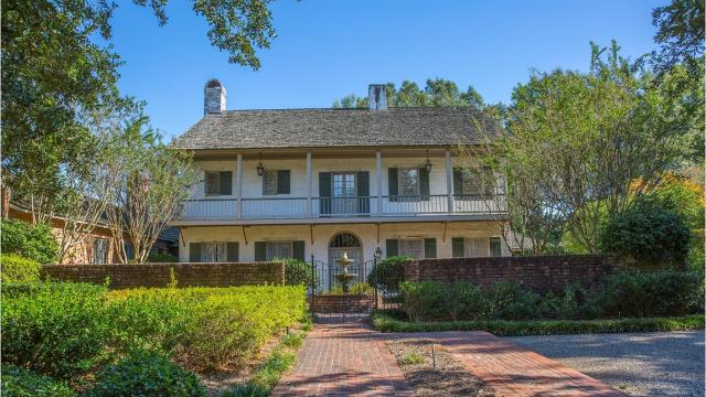 With large gallery porches and 13 ft. ceilings, 3402 Lake DeSiard Drive is an example of classic Louisiana architecture. A plaque certifies that it was an original design by architect A. Hays Town. It overlooks Bayou DeSiard.